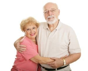Attractive senior couple wearing new glasses.  Isolated on white.